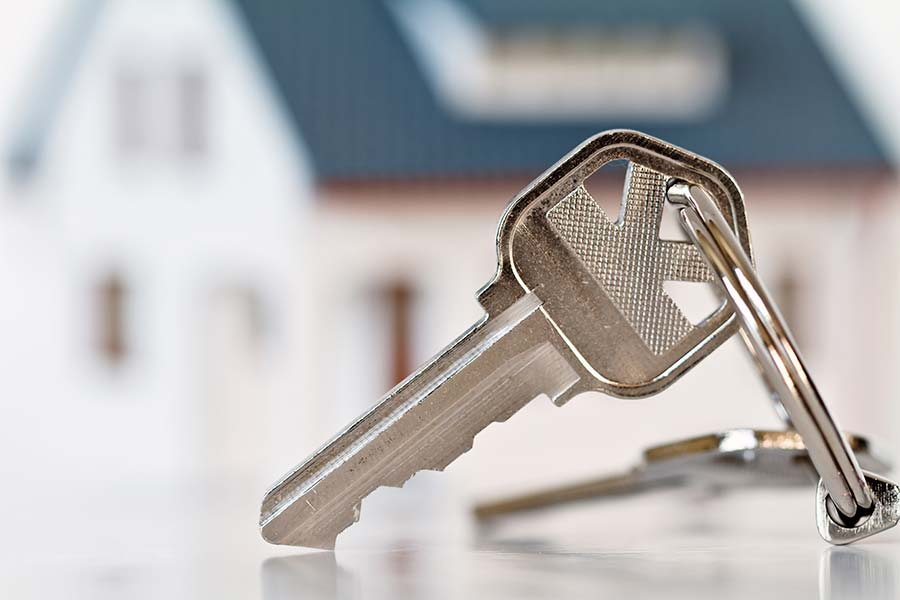 Keys in front of a new home that just passed through our home inspection services